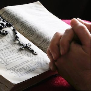 hand-bible-rosary
