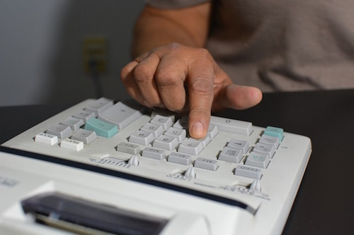 accountant using calculator